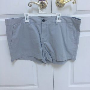 Light blue / gray shorts